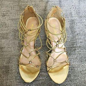 ANNE MICHELLE golden heels